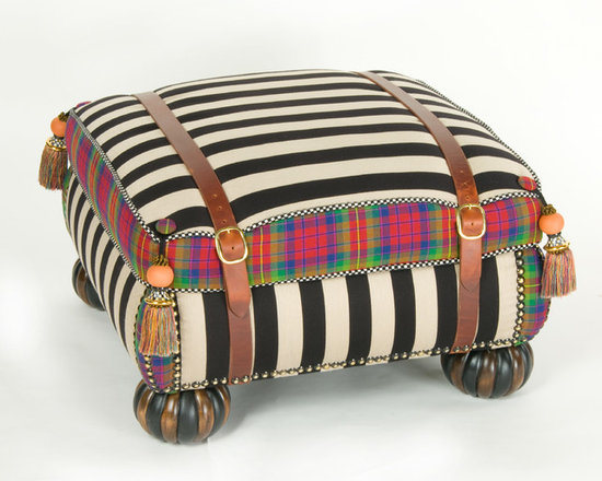 Courtly Campaign Ottoman | MacKenzie-Childs - Our Courtly Campaign Ottoman is not your everyday footrest, upholstered in a bold black and taupe stripe juxtaposed against our 100% wool jewel-tone MacKenzie tartan. Made especially for us in Scotland. Accented with wide leather strapping; festive terra cotta and silk fringed tassels; and carved, fluted bun feet. Inject a sense of over-the-top style into your sitting room by setting this updated classic out on its own or with the companion club chair. Add a glass top to turn it into a most imaginative table.