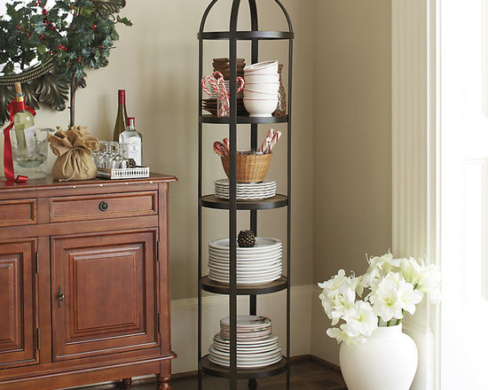 Ballard Designs - Lyon Round etagere - Great paired in dining room corners. Turned finial crown. When you need extra shelf space and don't have the floor space, think vertically. Our Lyon Round Etagere holds stacks of dishes in the kitchen or tons of toiletries in the bath. Banded iron frame has four pine wood shelves with stained finish. Lyon Etagere features: . .