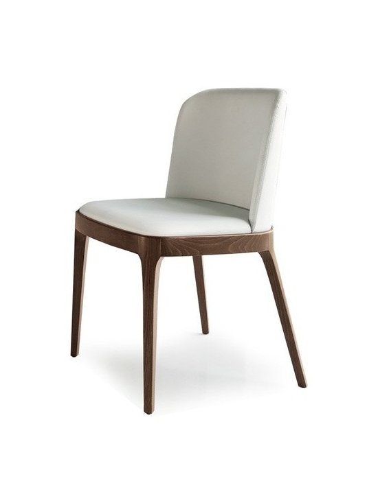 Cattelan Italia - Cattelan Italia | Magda Dining Chair - Made in Italy by Cattelan Italia.The Magna Dining Chair is a subtle exhibition of Italy's legacy of workmanship and design embedded in quality and functionality. Its classic elegance stems from its low profile, minimalist design. Premium soft leather wrapped over generously cushioned seat and slightly rounded backrest lends an element of luxury to the piece. While complementing its classic look, four solid timber legs tastefully keep the seat steady. The chair's slim silhouette makes it ideal for tight spaces and for pairing with coffee, side and dining tables in any traditional setting. The absence of arms gives a sense of openness and enables unrestricted movement. Options for wood finish and leather offered.
