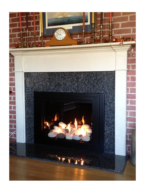 New Kozy Heat Jordan Series, Rockford gas insert - AFTER: New granite hearth, surround and mantel supplied and installed by Connecticut Appliance and Fireplace Distributors.