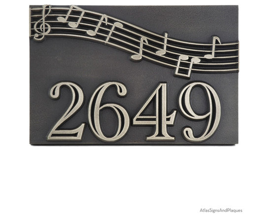 "Musical Notation Plaque 12"" x 8"" in Silver Nickel - Strike the right note with the Musical Notation Plaque. Some homes, and the families that live there are just lyrical and happy by nature. Here is a way to show arriving guests that they can expect something between a full symphony orchestra and dueling pianos when they enter your personal concert hall. Fun and music are a given fact at your home and this is a great way to project it in a most inviting way."