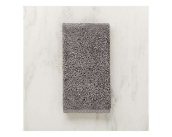 Grandin Road - Micro Cotton Hand Towel - Soft, super absorbent and quick-drying MicroCotton towels and matching towel-style bath mat. Made from 100% long staple, very fine cotton. Rated the best cotton towel in America by Real Simple magazine. Fiber length and density allow towels and mats to absorb moisture 250% faster than a regular cotton towel. 600 GSM weight. Extra absorbent and rated the best cotton towel in America by Real Simple magazine, MicroCotton towels make a great addition to the master or guest bath. Each size is sold individually and made from exceptionally soft, silk-like, 100% long-staple cotton fibers that weigh in at 600 grams per square meter. Each cotton fiber is very fine and longer than those used in some of the finest Egyptian cottons: each loop is made up of 120 fibers, whereas regular cotton towel loops are made of 30 to 40 yarns. Each size is available in a wonderful array of hues; the color selection coordinates perfectly with the Reversible Cotton Bath Rug.. . . . . Machine washable: wash dark colors separately in cool water (40 degreesF), do not use bleach or products containing benzoyl peroxide. Towel-style bath mat does not have a rubber backing. Each piece sold separately. Imported.