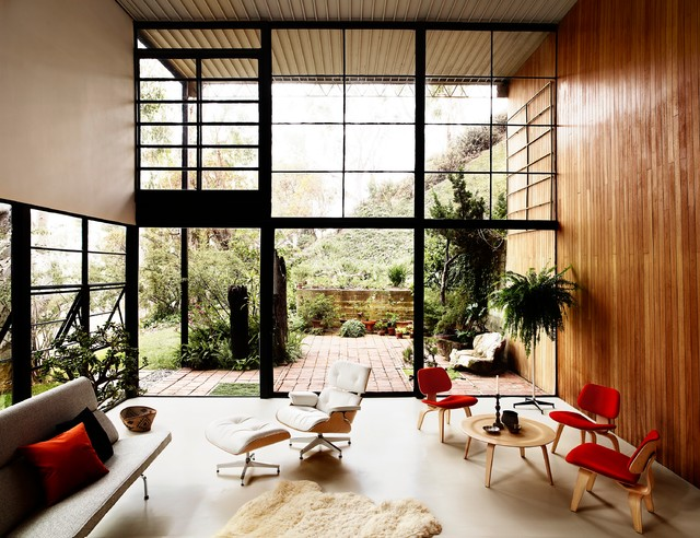 Family room with Herman Miller Eames Lounge Chairs modern-family-room