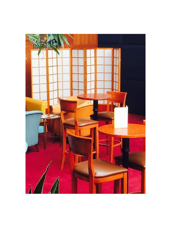 Room Dividers, Folding Screens, Partitions, Decorative Screens, Ideas - This lounge in a hotel uses multipanel shoji screen room dividers to cover up the extra chairs that are stacked in the corner in case they are needed for more customers