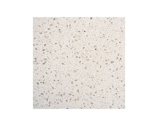 Iced White - Iced White Quartz is a polished slab quartz ideal for both residential and commercial projects with its soft shades of white and accents of gray. This durable polished slab granite is perfect for indoor applications including countertops, backsplashes, and more.