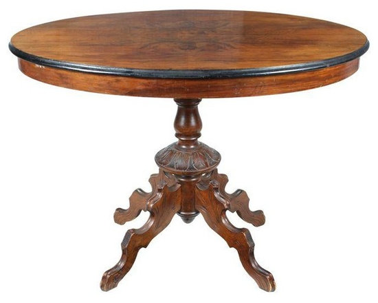 Pre-owned 19th Century Walnut Oval Table - French 1880s burr walnut oval table with unique hand carved pedestal base and carved quad base.  Minor veneer damage on table top as shown in photo.