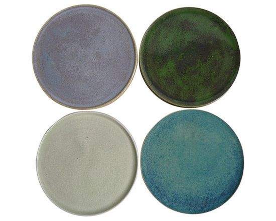 Set of 4 Coasters - Sold as set of 4. These beautiful coasters boast rich, vibrant colors that will accent the coffee table. They are the perfect size to use under most cups, glasses and mugs. They'll even fit perfectly to catch the stray drip under a bottle of wine. These coasters make an ordinary item into a little disc of art.