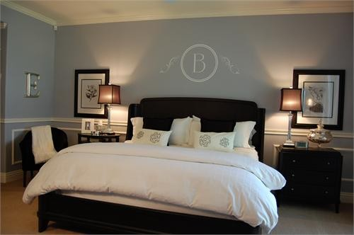 grey blue bedroom with dark furniture