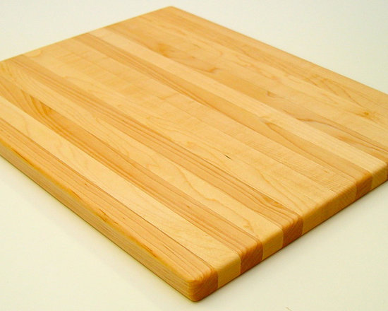 Cutting Boards - Country Cabinets can make custom cutting boards.  Butcher Block boards, to bread boards, any wood species you like.