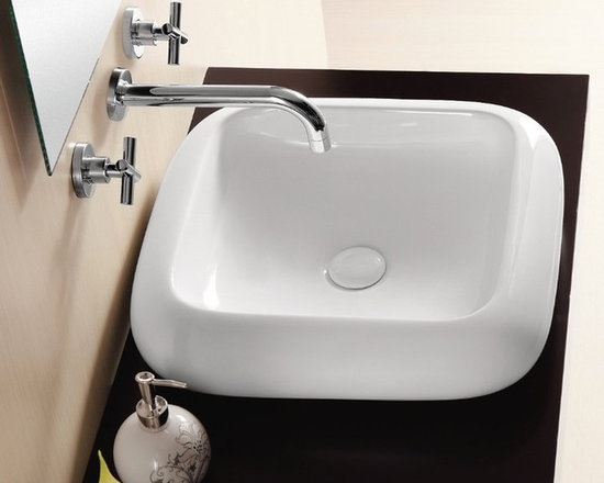 "Caracalla - Square Modern Style Vessel Sink by Caracalla - Modern square bathroom sink with rounded corners and edges made of high quality white ceramic. Elegant above counter vessel sink comes without overflow and has no option for faucet holes. Designed in Italy by Caracalla. Sink dimensions: 19.09"" (width), 4.33"" (height), 19.09"" (depth)"