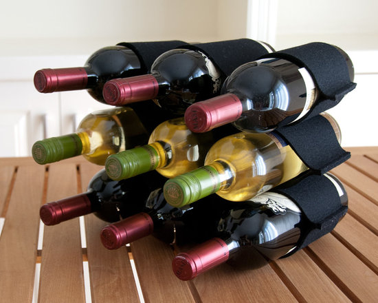 Felt Wine Rack - This stylish designer felt Wine Rack is made of the highest quality 100% wool and is easily stored when flat or upright. Holds 9 wine bottles, it can be stood upright or on it's side. Add a natural style when entertaining guests.