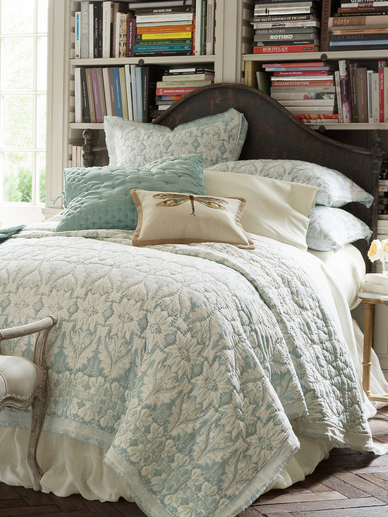 Jourdan Park Quilt - Landscaped with rows of stylized art nouveau florals, our Jourdan Park quilt brings an air of relaxed elegance to the bed. Hued in serene shades of pearl blue and white, this frothy, light confection of pure cotton voile is sublimely soft to the touch. The double flange border (sheer white over floral) is finished with frayed edges to confer a note of vintage flair and take the formality down another notch. Quilt reverses to the same pattern in inverted colors for subtle variation and twice the look. Coordinates with the matching Jourdan Park shams (sold separately).