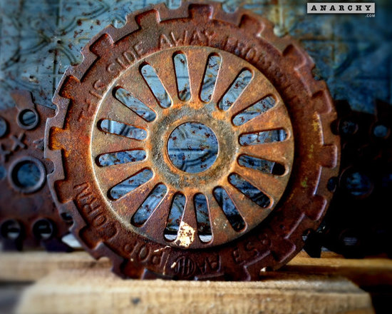 """Antique Industrial Gear Decor - Fantastic turn-of-the-century wheel of thick cast iron in a hardcore industrial design. Reclaimed lumber display stand. 7 5/8"""" diameter."""