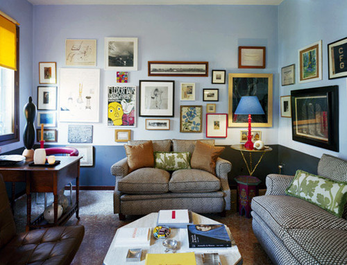 Living room with blue walls and pictures/posters eclectic