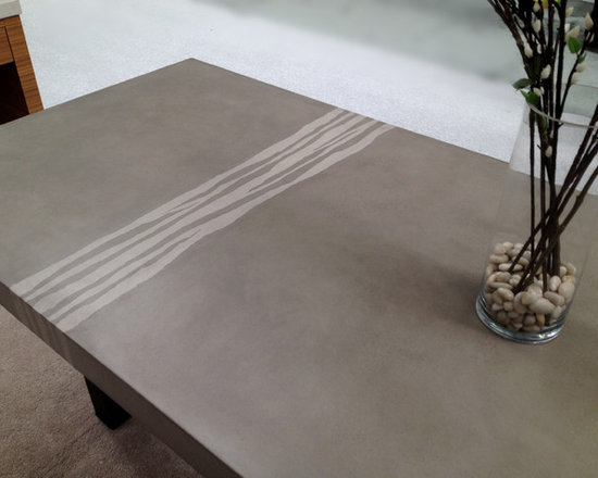 Dining Table - Trueform Concrete - Concrete dining table photo shows an integral design detail that runs through the concrete table top.