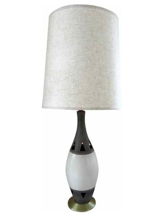 Modern Pottery Lamps - One Pair Available - This is a great pair of mid century modern table lamps made of ceramic on a brass base. The top and bottom sections of the lamp body are a textured gray pottery with triangle cut outs. The center portion is a smooth white ceramic which provides a nice contrast.