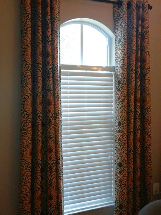 Drapery Ideas - Grommet panels over and arched window.
