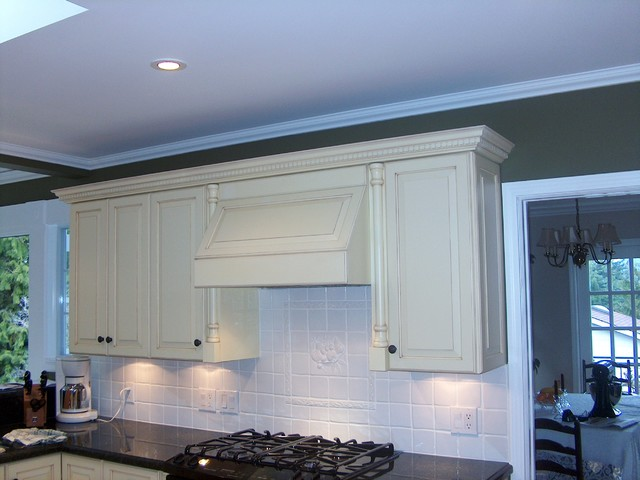 Antiqued White Cabinets & Range Hood - traditional - kitchen