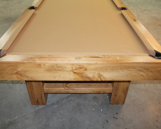 Michigan Made Custom Pool Tables - McClure custom made pool tables is a great addition to your basement. Made with one hundred percent North American hard maple wood, this table exudes a unique contemporary style. Not only will this be a focal point of your basement but it will also provide entertainment for you and your friends and family.