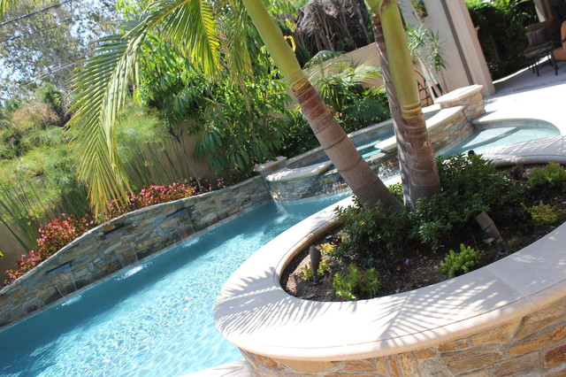 Pool and spa stacked stone wall water features pool for Pool design orange county