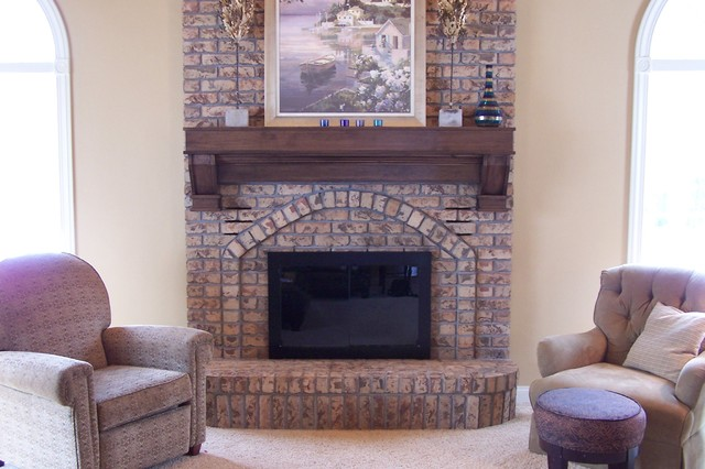 New wood mantel over existing brick traditional
