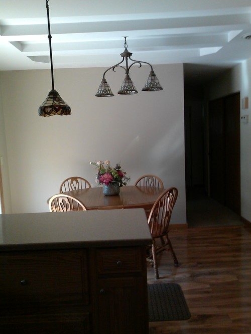 Off centered ceilings light fixture for Dining room table not centered under light