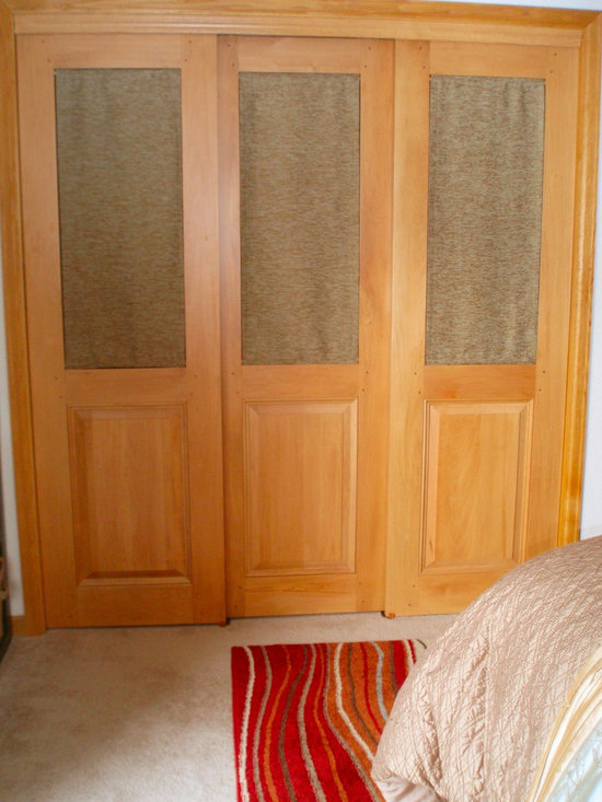 Closet Doors - Sometimes closet doors can give too heave a look to a room.   These doors feature a removable fabric panel at the top to keep the look and feel light while showing a solid wood, colonial raised panel at the bottom to keep things traditional.