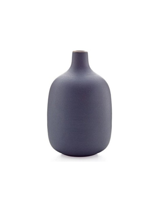 Single stem vase in indigo - Heath Ceramics new vase collection takes inspiration from the original Heath budvase designed in the 1950s, yet stands out for its refined, contemporary lines. Stunning with or without flowers, as a family, mixed and matched or on their own.
