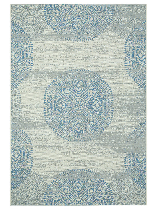 Finesse Mandala rug in Capri Blue - Finesse Mandala takes intricate and familiar patterns from centuries old designs and brings it into a landscape ... your backyard. Why should precious only live inside? Distressed and seemingly aged, these rugs will add contrast and richness to any deck or patio.