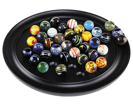 """Inviting Home - Venetian Glass Solitaire - Venetian glass solitaire game 11-3/4"""" x 1-3/8""""H * Gift packaged * 38 Venetian glass marbles (25mm. each) Venetian Glass Solitaire...individually hand-blown Venetian glass marbles full of color against a solid ebony board. Art in itself functional and fun as beautiful home accessorie and as solitaire game... The game of Solitaire is reputed to have been invented by a nobleman confined in the Bastille prison during the early years of the French Revolution. Solitaire game is played with 36 marbles. The object is to eliminate all but one marble which should ideally end up in the center of the game board. Contents: A collection of 38 (two spares) hand-made Venetian glass marbles. Game board made of non-endangered hardwood. To play: Fill all the indents with marbles then remove the center marble and place on the other ring. The player begins by selecting a marble that can jump over another marble in either horizontal or vertical directions and land in an empty space. Then the jumped marble is removed and placed on the outer ring. Continue jumping and removing marbles until no further moves are possible. In a perfect game one marble remains in the center."""