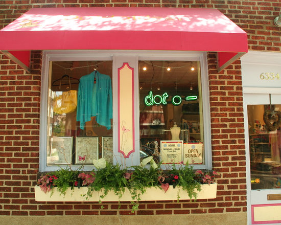 Commercial Container Garden - I created a colorful & whimsical garden for the front of this Clayton women & children's clothing boutique. The arrangement changed with the seasons.
