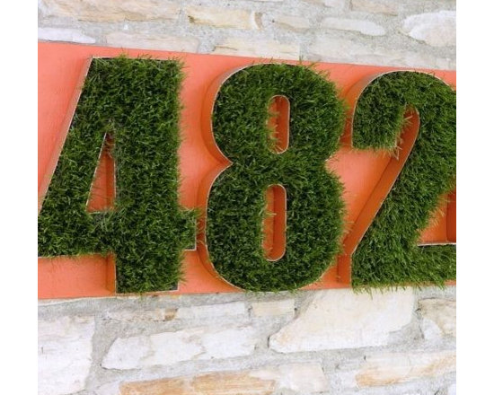 Grass Numbers - Now this is a new one. Grass numbers are definitely a new way to make a statement. The green stands out perfectly on the orange background. No one will miss this from the street.