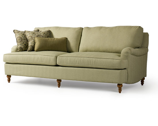 Hemingway Sofa - As the name Hemingway suggests, this time-honoured sofa is based on an enduring style from history. Reminiscent of the English roll arm, this full-size sofa has two full seat and back cushions making it truly comfortable. Low and softly rounded arms make it great for spaces where you want both comfort and conversation. Shown in seafoam green herringbone, its unique legs update this piece and give it new character for future generations.