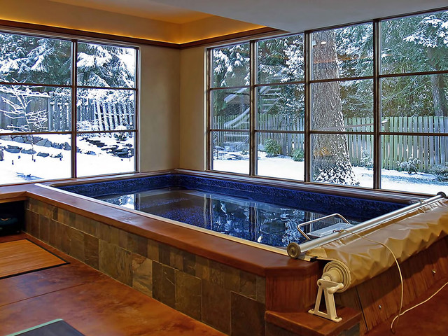 Indoor endless pool inground swimming pool for Swimming pool room ideas