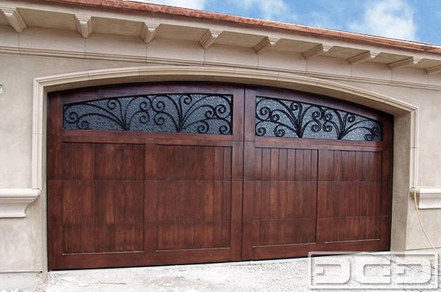 Mediterranean Revival 04 | Custom Wood Garage Door WIth Iron Window Scrolling mediterranean-garage-and-shed