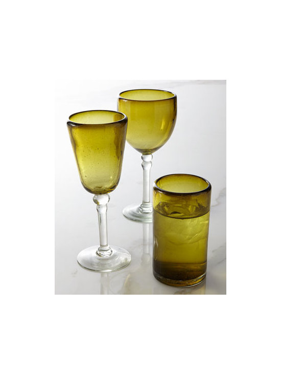 "Horchow - Olive Glassware - Exclusively ours. Richly hued eco-friendly glassware brings warm color to table settings. Made of recycled glass. Hand wash. Each style sold in sets of four. Highball holds 12 ounces; 3""Dia. x 5""T. Cup goblet (shown left, front) holds 10 ounces;...."