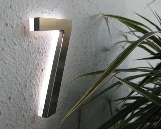 """LED House Numbers & Apartment LED Numbers - These are modern Illuminated Architectural LED House Numbers suitable for wet outdoor locations. The standard size is 5"""" inches made from solid aluminum cast with a solid acrylic back panel that houses the CREE or OSRAM LED chips. We offer custom size and design solutions for contract projects."""