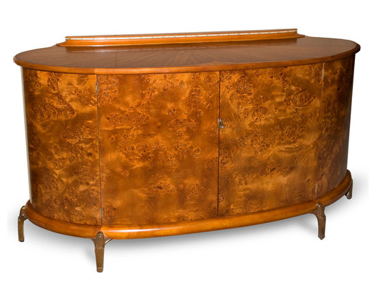 Eclipse Credenza - A WILLEM SMITH showpiece, the delicate beauty of the Eclipse Credenza belies its buffet functionality. The curvature and stunning woods of the doors are accentuated by the solid wood edge banding and the hand cast bronze feet allowing you to appreciate its simple beauty without distraction.