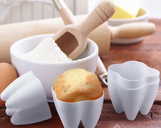 Sweet Tooth Cupcake Molds - Brush up on the fine art of baking and serve your guests a Sweet Tooth. Each white silicone tooth bakes up a perfectly-sized individual cupcake, ready to sink your teeth into! Four Cupcake bakers in each set, packaged in a full color peggable gift box.