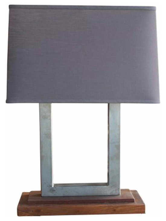 Plaza Lamp - Our Plaza Lamp features a dark linen shade topping brushed steel, sitting on a stepped walnut base.