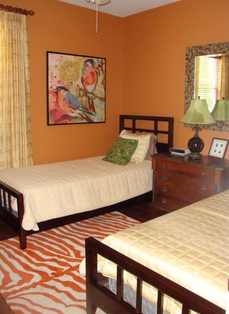 Funky guest room with orange walls and orange zebra rug eclectic-bedroom