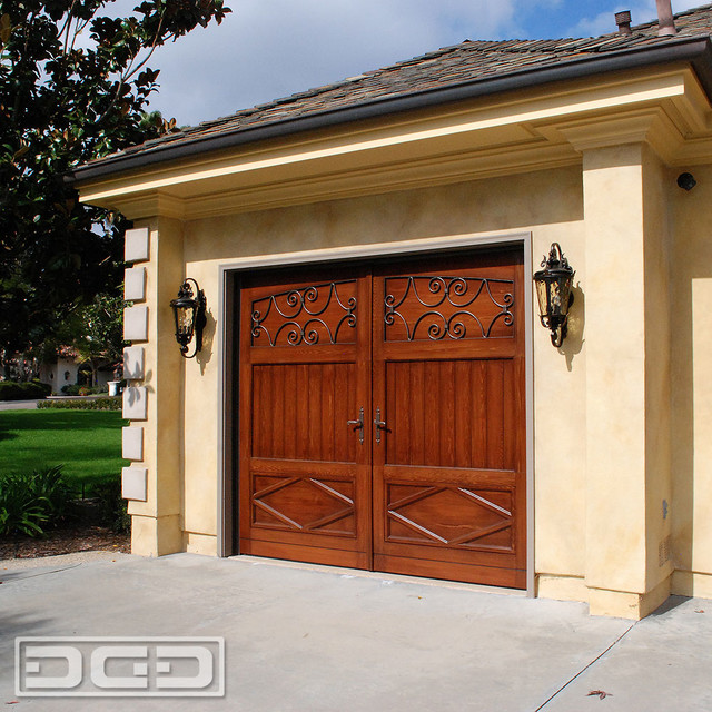 French Garage Door Design With Decorative Iron Inserts And