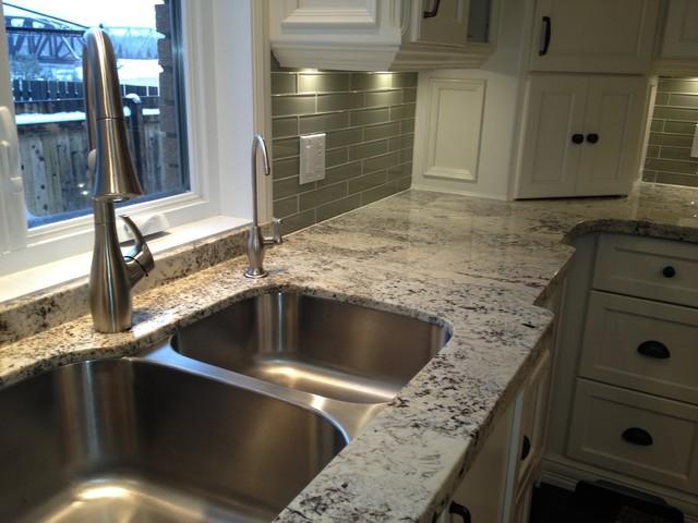 Arctic cream granite on cream cabinets contemporary for Arctic white kitchen cabinets
