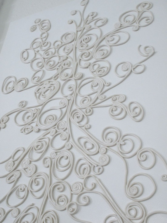 Swirl; Ceramic Installation on Panel - Created with Porcelain or White Earthenware. Each strip is individually hand-rolled, cut, and altered; then glaze fired.