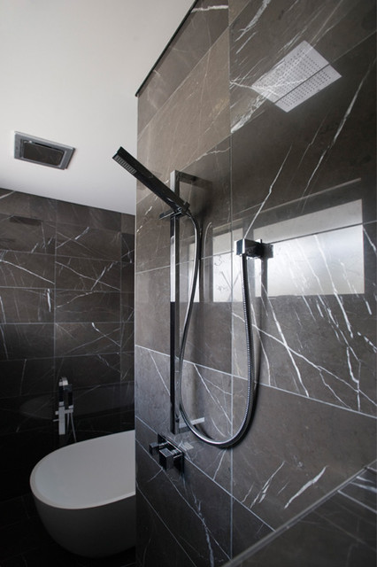 Open shower with rain soaker and rail