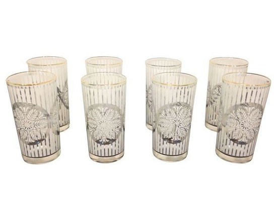 Used Gold Rimmed Snowflake Highball Glasses - Set of 8 - This set of 8 vintage glasses will add a touch of glamour and nostalgia to your Holiday entertaining. Rimmed in gold, they feature white snowflakes and stripes, and are in excellent vintage condition.