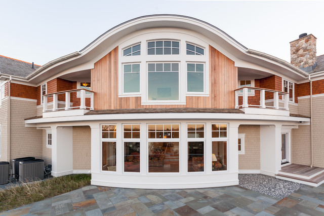 orleans waterfront home curved exterior wall and slate patio contemporary exterior