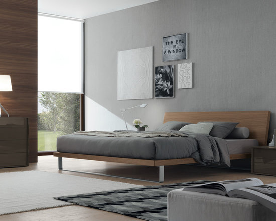 Avril Bed - Avril Bed is designed by Enrico Franzolini. Wooden bed with metal base titanium finished. Finishes in dark oak, walnut, brushed wood matt lacquer, matt and gloss lacquer.