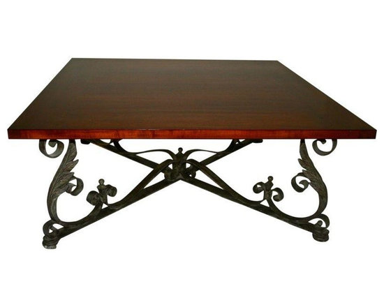 Pre-owned Foilage Wrought Iron Cocktail Table - A unique, tasteful cocktail table with a wrought iron base, foliage and scrolling accents. It features a warm, solid wood top with some scratches and marks (see pictures). The table is made with beautiful craftsmanship. This table is ready for many more family gatherings and cocktail parties!