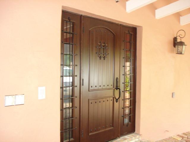 Single mahogany door with decorative mahogany sidelights for Decorative main door designs